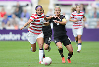 Newcastle, England - Friday, August 3, 2012: The USA women defeated New Zealand 2-0 in the quarterfinal round of the 2012 Olympics at St. James Park. Sydney Leroux (11) fights for the gall with Rebecca Smith (6).