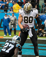 The Carolina Panthers played the New Orleans Saints for supremacy in the NFC South.  December 22, 2013 at Bank of America Stadium.  The Panthers scored the winning touchdown with 23 seconds left in the game to give them the opportunity to clinch the NFC South with a win next week.  New Orleans Saints tight end Jimmy Graham (80) looks down at Carolina Panthers strong safety Quintin Mikell (27) after catching a touchdown pass.