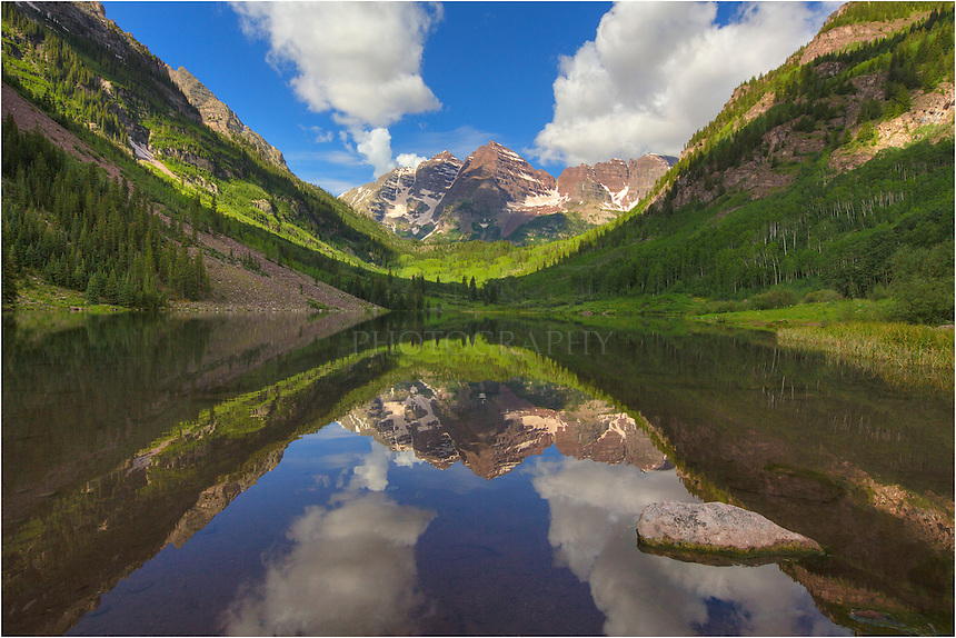 After arriving about 4:00am to photograph the Maroon Bells, one of Colorado's iconic locations for scenery, only to find a cloudy sky, I hiked over to Crater Lake. After this easy 2+ mile walk, I returned back to Maroon Lake and enjoyed a nearly perfect summer morning. The air was calm the water was almost still, and the reflection of the Maroon Bells in Maroon Lake was pristine. This Colorado landscape was captured on a summer morning in July in the Maroon Bells Wilderness area.