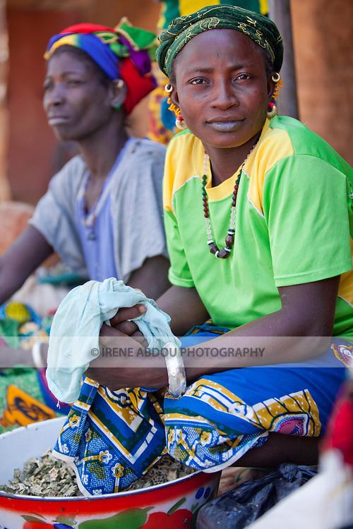 In the town of Djibo in northern Burkina Faso, women sell greens in the market.