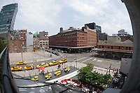Taxis line up in front of the Standard Hotel in the plaza viewed from the new High Line Park in the New York Meatpacking district on Sunday, May 28, 2012. The vacant lot across from the taxis, at the corner of West 13th Street and Washington Street, was formerly a meatpacking plant.  (© Richard B. Levine)