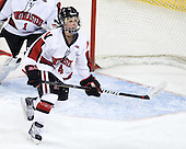 Maggie DiMasi (NU - 4) - The Harvard University Crimson defeated the Northeastern University Huskies 4-3 (SO) in the opening round of the Beanpot on Tuesday, February 8, 2011, at Conte Forum in Chestnut Hill, Massachusetts.