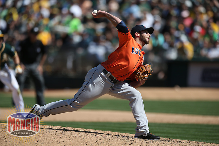 OAKLAND, CA - APRIL 19:  Anthony Bass #45 of the Houston Astros pitches against the Oakland Athletics during the game at O.co Coliseum on Saturday, April 19, 2014 in Oakland, California. Photo by Brad Mangin