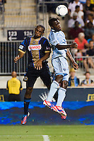 Amobi Okugo (14) of the Philadelphia Union goes up for a header with C.J. Sapong (17) of Sporting Kansas City. Sporting Kansas City defeated the Philadelphia Union 2-0 during the semifinals of the 2012 Lamar Hunt US Open Cup at PPL Park in Chester, PA, on July 11, 2012.