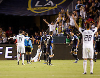 The LA Galaxy team and fans in the stands celebrates a Landon Donovan (10) goal. The LA Galaxy and the San Jose Earthquakes played to a 2-2 draw at Home Depot Center stadium in Carson, California on Thursday July 22, 2010.