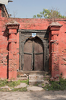 Kathmandu, Nepal.  Entrance to a neglected neighborhood temple illustrates the need for preservation or restoration.
