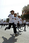 Palestinian girls run during students' marathon in the West Bank City of Nablus, October 31, 2013. Hundreds of school girls from 10 to 15 years participated in the marathon organised by the directorate of education in Nablus. Photo by Nedal Eshtayah