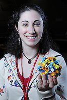 New York, NY, USA - June 24, 2011: Marina Musicus, an Origami folder from Massachussetts, at the OrigamiUSA Convention in New York City holding a modular design she has folded.