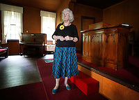 NWA Democrat-Gazette/DAVID GOTTSCHALK - 5/19/15 - Susan Shelton McRae, a member of the Rural Builders Club, an all-female group, is the granddaughter of one of the four founding women of the club, stands in the chapel of Son's Chapel in Fayetteville before a soup lunch is served Tuesday May 19, 2015. A 75th anniversary of the dedication of the chapel with an open house is planned for May 30.