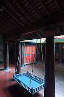 Courtyard with hanging cot. Interior of a home in Thittacheri.
