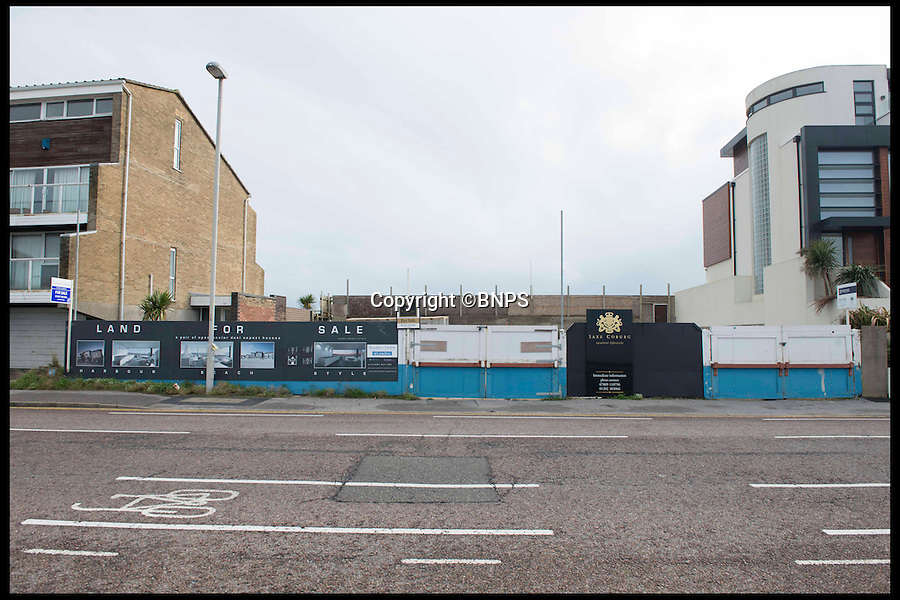 BNPS.co.uk (01202 558833)<br /> Pic: LauraDale/BNPS<br /> <br /> Boarded up: The front of the plot on Banks Road.<br /> <br /> A narrow empty plot of land in the world-renowned Sandbanks area is on the market for &pound;6.25million.<br /> <br /> The piece of land is worth &pound;2m more now its empty than it was when the owner bought it with two semi-detached houses on it.<br /> <br /> The area in Dorset, often called Millionaire's Row, is said to be the fourth most expensive place in the world to live and this plot is one of the few left to redevelop.