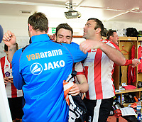 Lincoln City players, from left, Jamie McCombe, Luke Waterfall and Matt Rhead celebrate in the changing rooms after the game<br /> <br /> Photographer Chris Vaughan/CameraSport<br /> <br /> Vanarama National League - Lincoln City v Macclesfield Town - Saturday 22nd April 2017 - Sincil Bank - Lincoln<br /> <br /> World Copyright &copy; 2017 CameraSport. All rights reserved. 43 Linden Ave. Countesthorpe. Leicester. England. LE8 5PG - Tel: +44 (0) 116 277 4147 - admin@camerasport.com - www.camerasport.com