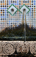 The Bab al Okla fountain with 2 water spouts, a carved stone water trough and a typically Tetouan zellige tile wall, built under the Caid governor Mohammad Ben Omar Luqash, 1751-58, opposite the Bab al Okla gate in the medina or old town of Tetouan on the slopes of Jbel Dersa in the Rif Mountains of Northern Morocco. Tetouan was of particular importance in the Islamic period from the 8th century, when it served as the main point of contact between Morocco and Andalusia. After the Reconquest, the town was rebuilt by Andalusian refugees who had been expelled by the Spanish. The medina of Tetouan dates to the 16th century and was declared a UNESCO World Heritage Site in 1997. Picture by Manuel Cohen