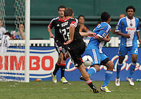WASHINGTON, D.C. - AUGUST 19, 2012:  Chris Kolb (22)  of DC United blasts the ball off Carlos Valdés (2) of the Philadelphia Union during an MLS match at RFK Stadium, in Washington DC, on August 19. The game ended in a 1-1 tie.