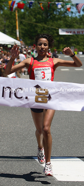 Fatami Ayachi from Braircliff Manor, NY. took first place in the woman's division with a time of  41 minutes 05 seconds during the 30th annual Litchfield Hills Road Race Sunday Afternoon in Litchfield. Michael Kabelka / Republican-American