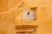 Sundial on an apricot stucco wall in the courtyard of the Mausoleum of Moulay Ismail, or Moulay Ismail Ibn Sharif, reigned 1672ñ1727, second ruler of the Alaouite dynasty, built 1703 by Ahmed Eddahbi, Meknes, Meknes-Tafilalet, Morocco. Meknes is a fortified Imperial city redeveloped under Sultan Moulay Ismail, 1634-1727, as Morocco's political capital. Picture by Manuel Cohen