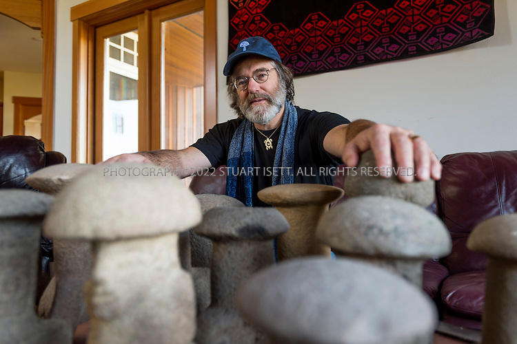 3/22/2013--Shelton, WA, USA..Paul Stamets poses with ancient Mayan mushroom stones he has collected in keeps in his home on his mushroom farm in Shelton, WASH., south of Seattle...Paul Stamets, 57, is an American mycologist, author, and advocate of bioremediation and medicinal mushrooms and owner of Fungi Perfecti, a family run business that specializes in making gourmet and medicinal mushrooms. ..©2013 Stuart Isett. All rights reserved.