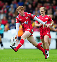 Rhys Patchell of the Scarlets puts boot to ball. Pre-season friendly match, between the Scarlets and Bath Rugby on August 20, 2016 at Eirias Park in Colwyn Bay, Wales. Photo by: Patrick Khachfe / Onside Images