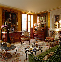 The drawing room is furnished with antiques from a mixture of periods and an exotic combination of fabrics