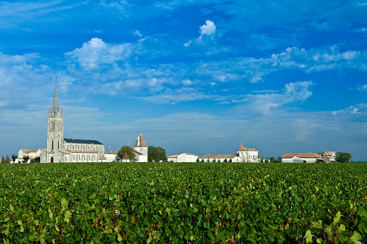 Vineyards and Church of St Jean at Pomerol in the Bordeaux wine region of France