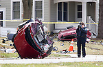 Madison Police on the scene of a car accident on South Midvale blvd North of Mineral Point Rd. Monday April 4, 2011. Early reports are that the car was stolen and was being pursued by the police at the time of the accident. Steve Apps-State Journal.
