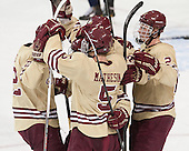 Kevin Hayes (BC - 12), Michael Matheson (BC - 5), (Gaudreau, Arnold) and Patrick Brown (BC - 23) celebrate. - The Boston College Eagles defeated the visiting University of Notre Dame Fighting Irish 4-2 to tie their Hockey East quarterfinal matchup at one game each on Saturday, March 15, 2014, at Kelley Rink in Conte Forum in Chestnut Hill, Massachusetts.