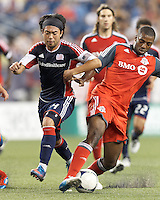 Toronto FC substitute defender Aaron Maund (21) blunts New England Revolution midfielder Lee Nguyen (24) attack. In a Major League Soccer (MLS) match, Toronto FC defeated New England Revolution, 1-0, at Gillette Stadium on July 14, 2012.