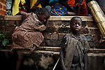 DUBIE, DEMOCRATIC REPUBLIC OF CONGO DECEMBER 5: An unidentified boy and girl arrived with their family among thousands of newly arrived refugees who gathered outside a school on December 5, 2005 in Dubie, Katanga Province in Congo, DRC. They have been fleeing fighting between the Congolese army and Mai-Mai rebels in Eastern Congo. They are some of the victims of the civil war that started in 1996. Many people have moved from area to area the last years trying to find safety. About four million people have died in Congo since 1996, making it the deadliest humanitarian crisis in recent memory. Most of people have died of preventable diseases such as malaria, measles, diarrhea, respiratory infections and malnutrition. The health system has collapsed and very few people have access to healthcare. Congo is planning to hold general elections by June 2006, the first democratic elections in forty years. (Photo by Per-Anders Pettersson/Getty Images).