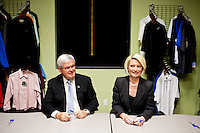Republican presidential candidate Newt Gingrich and his wife Callista Gingrich, right, sign books following a campaign town hall meeting at Level 10 Apparel on Monday, December 19, 2011 in Hiawatha, IA.