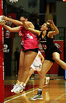 Catherine Latu beats Casey Williams to the ball during the International  Netball Series match between the NZ Silver Ferns and World 7 at TSB Bank Arena, Wellington, New Zealand on Monday, 24 August 2009. Photo: Dave Lintott / lintottphoto.co.nz