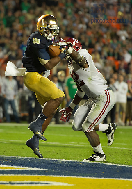 Jan. 7, 2013; Running back Theo Riddick scores touchdown past Alabama linebacker C.J. Mosley during the second half of the 2013 BCS National Championship in Miami, Florida. Alabama defeated Notre Dame 42 to 14. Photo by Barbara Johnston/University of Notre Dame