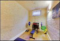 BNPS.co.uk (01202 558833)<br /> Pic: FrancisAmbler/Fine&amp;Country/BNPS<br /> <br /> One of the old cells has been converted in to a gym.<br /> <br /> Arrested development...<br /> <br /> A former magistrate's court and police station complete with original cells has been transformed into a quirky home - on the market for &pound;800,000.<br /> <br /> Although the building has had a makeover to a stylish home, the three cells for holding prisoners have been retained in their original form with one now serving as a study, another as a gym and the third as a utility room.<br /> <br /> The property was built in 1883 as part of Royston's police station and sergeant's house and also housed the magistrate's court for many years.