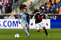 Bobby Convey (11) of Sporting Kansas City is marked by Sheanon Williams (25) of the Philadelphia Union. Sporting Kansas City defeated the Philadelphia Union 3-1 during a Major League Soccer (MLS) match at PPL Park in Chester, PA, on March 2, 2013.