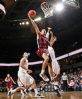 Nov 6, 2010; Charlottesville, VA, USA; Roanoke College g/f Clay Lacy (24) shoots the ball in front of Virginia Cavaliers f Akil Mitchell (25) Saturday afternoon in exhibition action at John Paul Jones Arena. The Virginia men's basketball team recorded an 82-50 victory over Roanoke College.