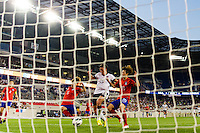 United States (USA) forward Abby Wambach (20) beats Korea Republic (KOR) defender Lim Seonjoo (6) and defender Kim Hyeri (20) to score. The women's national team of the United States defeated the Korea Republic 5-0 during an international friendly at Red Bull Arena in Harrison, NJ, on June 20, 2013.