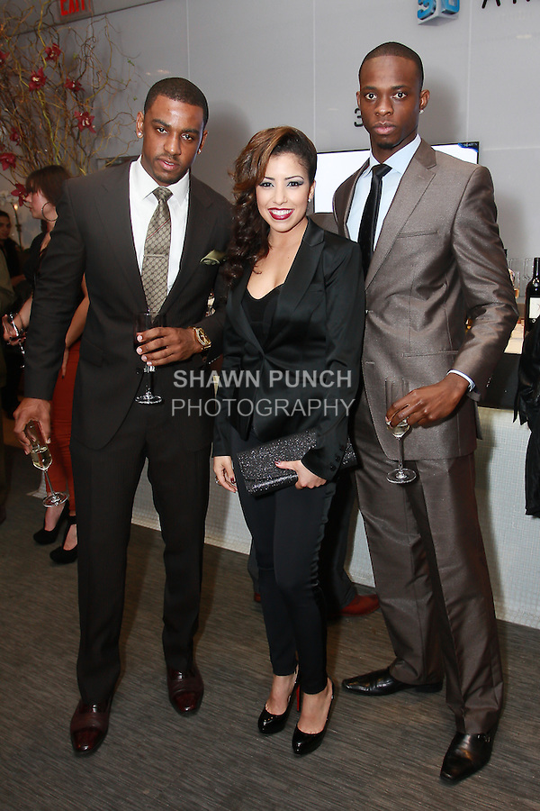 (l-r) Alvin Bailey, Amira Asfour, and guest attend the Aeon Magazine Launch Party, at the Samsung Experience in the Time Warner Center,  November 15, 2011.