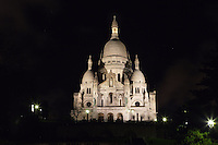 PARIS, FRANCE - JANUARY 19. A low angle view of Sacré-Coeur Basilica, on January 19, 2009, in Paris, France. Built between 1884-1914, the Basilica, whose clustered white domes are seen against a deep black night sky, was designed by Paul Abadie.  Built in white travertine on the top of the Butte de Montmartre, the Romano-Byzantine style Sacré-Coeur was designed as a monument to those who died in the Paris Commune during the Franco-Prussian War, 1870-71.  (Photo by Manuel Cohen)