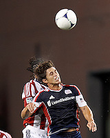 New England Revolution midfielder Ryan Guy (13) battles for head ball. In a Major League Soccer (MLS) match, the New England Revolution tied Chivas USA, 3-3, at Gillette Stadium on August 29, 2012.