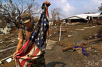 Pfc. Ronnie Borden pulls an American flag from the debris in Cameron, LA in the wake of Hurricane Rita. The Army National Guard, 528th Engineering Battalion from Monroe, LA are in Cameron, LA helping to clean up the disaster left in Hurricane Rita's wake. The unit returned from Afghanistan, April 30 only to respond to Hurricane Katrina in New Orleans and then, directly to Cameron, LA for Hurricane Rita. Wednesday, September 28, 2005. (James J. Lee / Military Times).