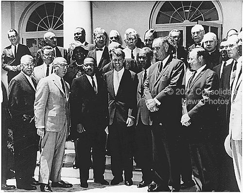 Photograph of a meeting at the White House in Washington, DC with Civil Rights leaders on June 22, 1963.  Front Row:  Martin Luther King, Jr., Attorney General Robert F. Kennedy,  Roy Wilkins, Vice President Lyndon Baines Johnson,  Walter P. Reuther,  Whitney M. Young, A Philip Randolph. Second Row, Second From Left:  Rosa Gragg.  Top Row, Third From Left: James Farmer.<br /> Credit: National Park Service via CNP