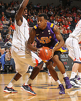 Jan. 2, 2011; Charlottesville, VA, USA; LSU Tigers guard Aaron Dotson (45) dribbles past Virginia Cavaliers guard K.T. Harrell (24) during the game at the John Paul Jones Arena. Mandatory Credit: Andrew Shurtleff