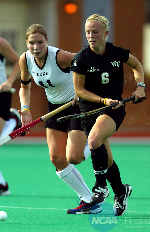 21 NOV 2004:  Forward Kelly Dostal (6) of Wake Forest races Duke back Kirsten Bostrom (11) for the ball during the Division I Women's Field Hockey Championship held at Kentner Stadium on the Wake Forest University campus in Winston-Salem, NC.  Wake Forest defeated Duke 3-0 for the national title.  Jamie Schwaberow/NCAA Photos