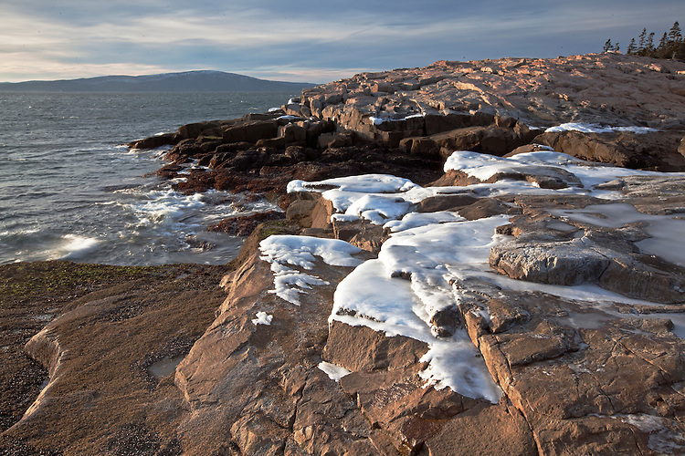 Ice-covered granite on the coastline of Schoodic Point on the Schoodic Peninsula, Acadia National Park, Maine, USA