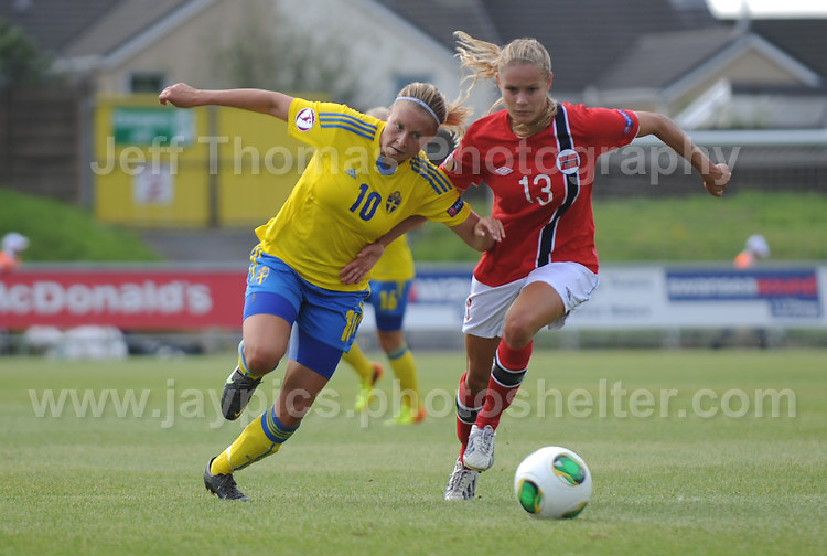 Fanny Andersson of Sweden tackles Andrine Tomter of Norway during the UEFA Womens U19 Championships at Stebonheath park Sunday 25th August 2013. All images are the copyright of Jeff Thomas Photography-www.jaypics.photoshelter.com-07837 386244-Any use of images must be authorised by the copyright owner.