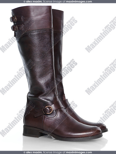 Knee-high brown leather fashion womens boots isolated on white background