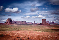 A view of Monument Valley looking west from Artist's Point with The East Mitten, Merrick Butte and several sandstone spires visible.