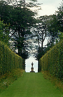 View down an avenue to the Four Faces Statue in the gardens of Bramham Park