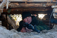 Kamenka, Karelia, Russia, 14/12/2007..A professional Russian soldier in the trenches during Snezhinka [Snowflake] 2007, a joint live fire training exercise for Russian and Swedish motorised infantry in which they play the roles of a combined peace-keeping force enforcing a demilitarised zone in a warring region.