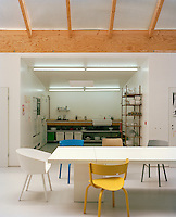 Looking from the open plan studio's dining area into the kitchen
