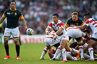 Fumiaki Tanaka of Japan passes the ball out. Rugby World Cup Pool B match between South Africa and Japan on September 19, 2015 at the Brighton Community Stadium in Brighton, England. Photo by: Patrick Khachfe / Onside Images